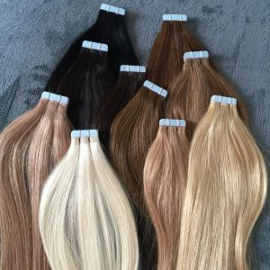 Semi-permanent tape in hair extensions